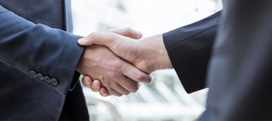 business broker shaking hands with client
